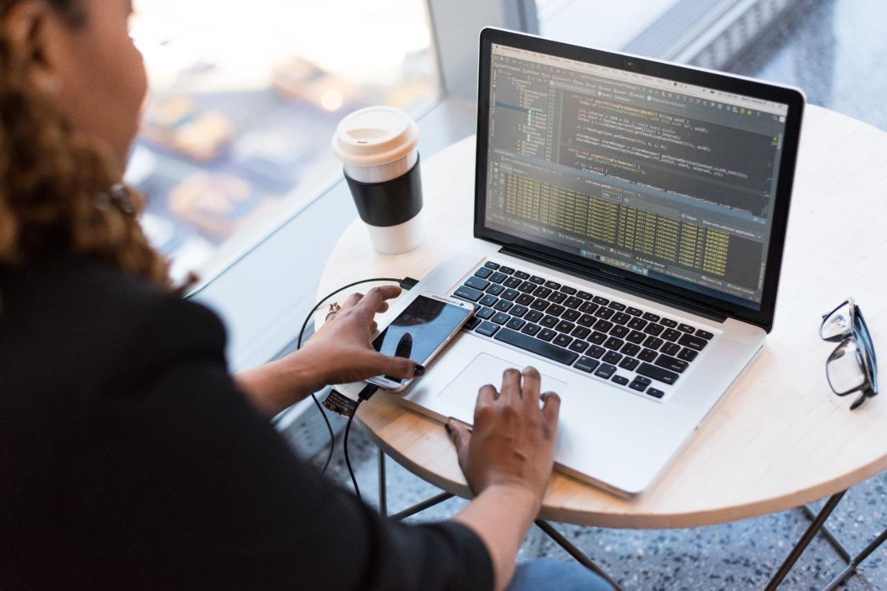 Debt Councilor Working on MacBook